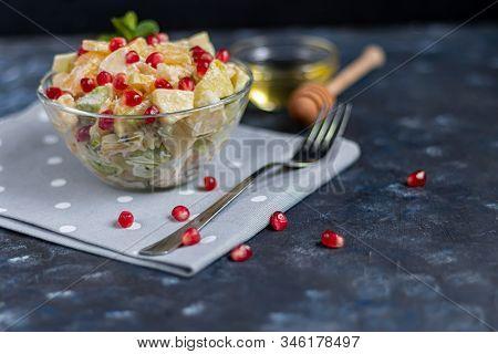 Diet Fruit Salad For Breakfast. Kiwi Orange Banana And Apple Diced And Seasoned With Yogurt With Hon