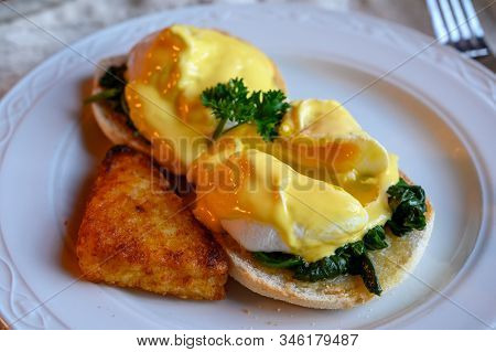 Weekend Vegetarian Breakfast In Scotland With Two Eggs Benedict On Homemade Muffuns With Spinach And