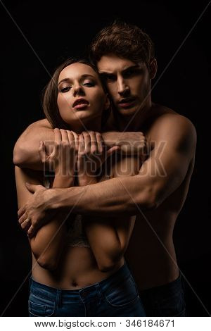 Sexy Young Couple Passionately Embracing Isolated On Black