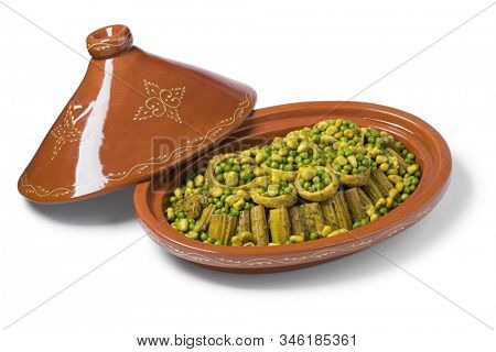 Traditional Moroccan oval tajine with Cardoon, stuffed artichoke hearts with green peas and broad beans isolated on white background