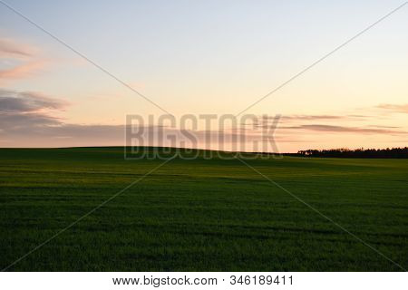 Sunset By Farmers Landscape With Green Rolling Hills