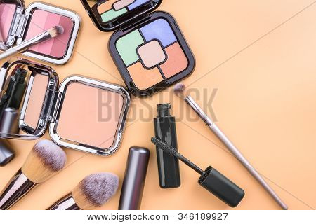 Flat View Of Cosmetics - Lipstic, Face-powder, Brushes.
