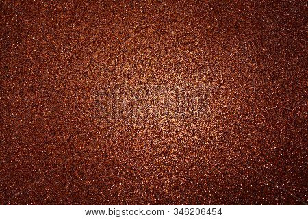 Red Glittery Background With Light In The Centre