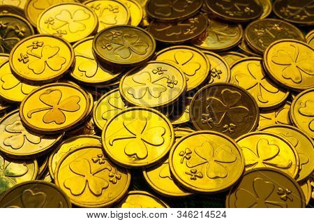 St Patrick's Day background. Golden coins with shamrock, St Patrick's day concept. St Patricks day festive composition with golden coins, St Patrick's Day background. Golden coins with shamrock under soft sunshine, St Patrick's day concept. St Patricks da