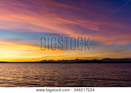Many Colors Fill The Sky As The Sun Set Over The Puget Sound.