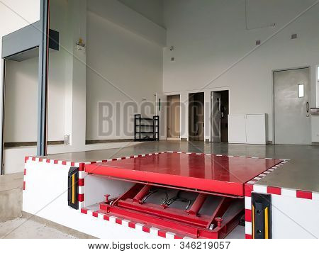 Industrial Equipment And Goods Loading, Unload Area With Red Steel Life. Help People To Move Heavy O