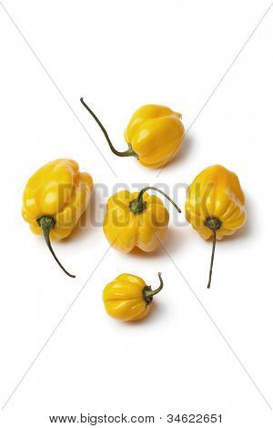 Yellow Scotch bonnet chili peppers on white background