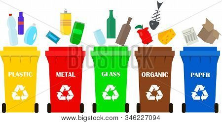 Garbage Containers Of Different Colors. Organic Waste, Paper, Plastic, Glass, Metal Recyclable. Sepa