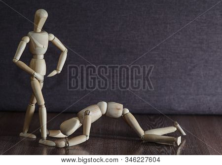 Femdom. Wooden Figures. The Woman Dominates The Man. Household Slavery. Inequality Of The Sexes.