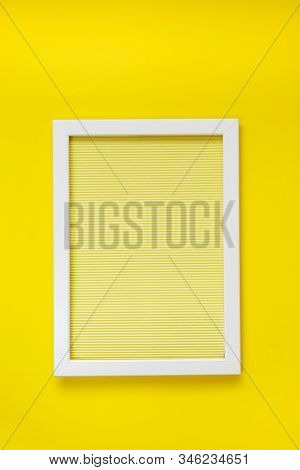 Empty  White Frame On Yellow Texture Of Crumpled Paper In The Volume Of Horizontal Lines Hanging On