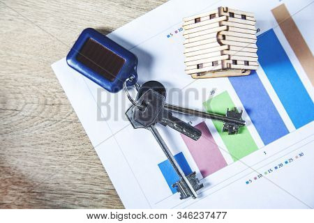 Wooden House Model With Key On Document