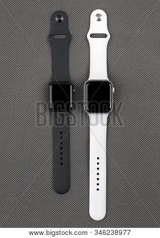 Rostov-on-don, Russia - December 2019. Two Smart Watches Apple Watch On A Gray Background. New Smart