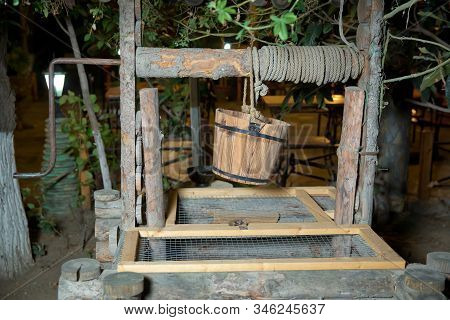 An Old Well And A Bucket Of Water .old Wooden Well Water .old Stones And Wooden Wells .well And Buck