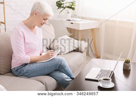 Well Organized Senior Lady Writing To-do-list And Plans For Retirement, Empty Space