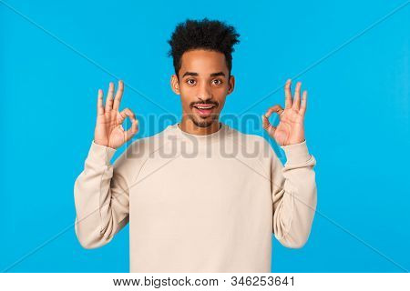 Alright, Sounds Good. Intrigued African-american Male Agrees Participate Event, Showing Okay Gesture