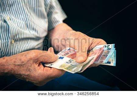 Old Man Sitting At Home Counting Her Money
