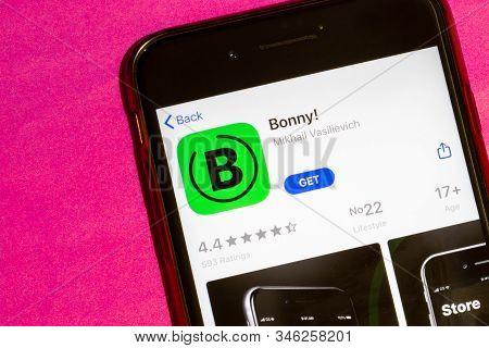 Los Angeles, California, Usa - 22 January 2020: Bonny Logo On Phone Screen Flat Lay With Purple Back
