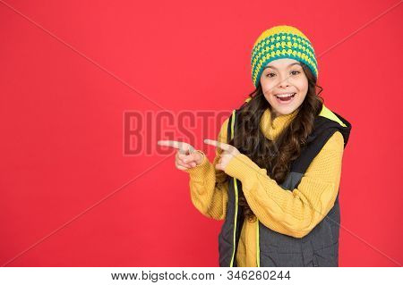 Good Stuff That. Happy Girl Pointing Index Fingers Red Background. Small Child In Winter Style Point
