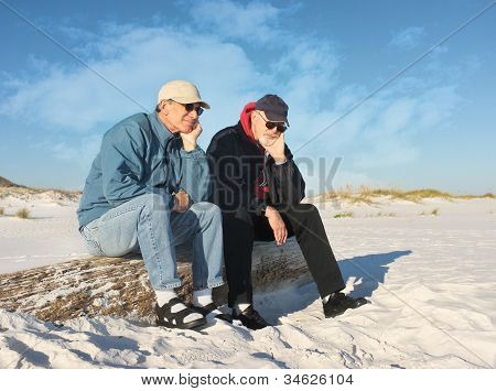 Two Bored Retired Men At The Beach