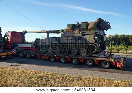 Over-standard, Atypical Road Transport. A Howitzer On The Tank Chassis. Exceptional Convoy. Long Veh