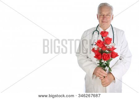 Doctor with Red Rose. A doctor or surgeon holds a long stem red rose. Isolated on white. Room for text. Clipping Path. Doctors deserve love and affection. Happy Valentines Day. Long Stem Roses.