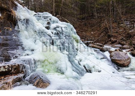 Scenic View Of Frozen Bastion Falls At Upstate New York