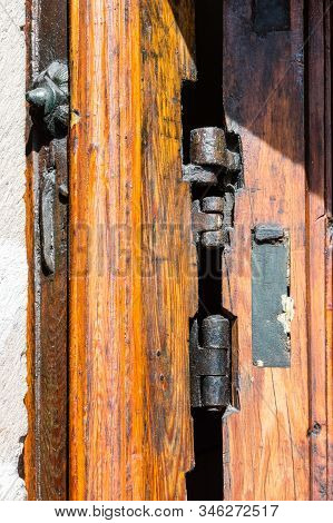 Old Wood Texture With The Woodworm Holes And Hinge The Door