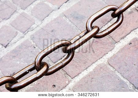 Metal Chain As The Fence On Street