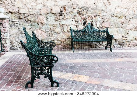 Metal Church Bench With Ornamental Style On Patio