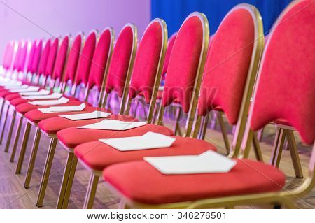 Rows Of Red Chairs In Conference Hall, Empty Meeting Or Event Room. Empty Guest Seats
