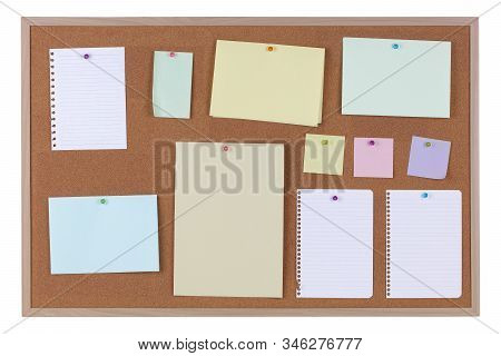 Paper Reminder Notices On A Cork Notice Board On White Background With Clipping Path