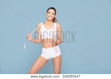 Active Happy Fit Girl With Centimeter.
