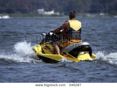 Jet Skiing In Yellow