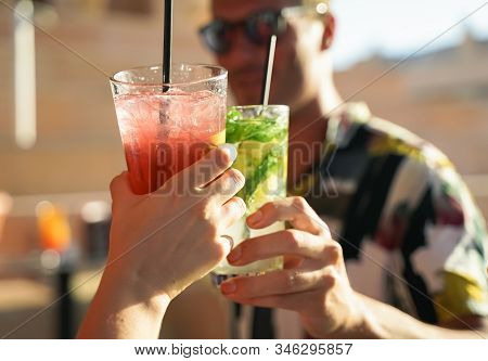 Happy Friends Having A Party Drinking Cocktails. Fashionable Teenagers Celebrating Holiday. Hands An