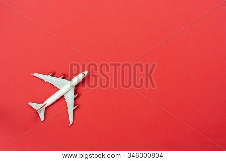 Table Top View Accessory Of Accessory Travel In Holiday Background Concept.flat Lay Of White Airplan