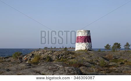 View Of The Shore Of The Baltic Sea Up North. Cliff, Rocks And Islands. Barren. Navigation Mark, Cai