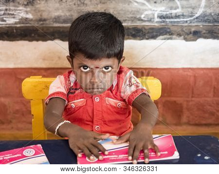 Puduchery, India - December Circa, 2018. Unidentified Cute Beautiful Poor Concentrated Kid Reading A