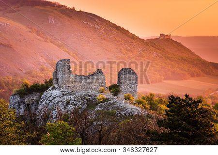 Sirotci Hradek Ruins And Devicky Castle Behind, Palava, Czech