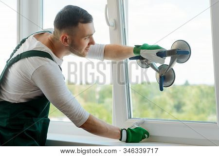 Man Is Replacing Glass In Window Using A Vacuum Lifter
