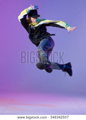 Breakdancing Young Man In Hoodie And Baseball Cap. Dance School Poster. Copy Space. Battle Competiti
