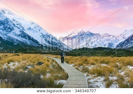 Hiking In Mountains At Winter. Mountain Landscape With Hiking Trek And Human At Sunset