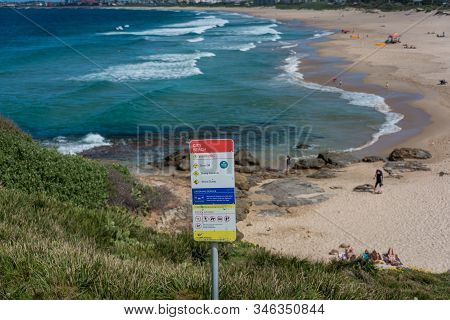 Wollongong, Australia - September 20, 2015: Warning Sign On Wollongong City Beach With Beach On The