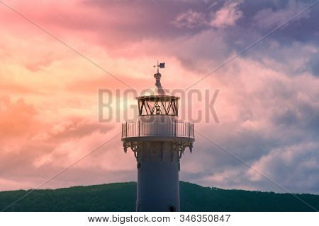 Close Up Of Old White Lighthouse Tower With Epic Sunset Sky On The Background. Beacon Lighthouse Lan