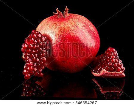 Pomegranate Fruit. Pomegranates Over Black Background. Organic Bio Fruits