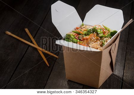 Rice With Vegetables And Chicken. Set Of Take-out Box And Chopsticks