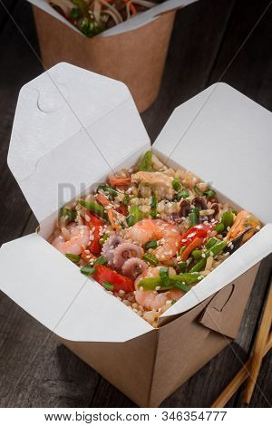 Chinese Rice With Seafood. Top View On Takeout Box Of Stir-fried Rice