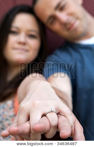 Engaged Couple Shows Diamond Ring