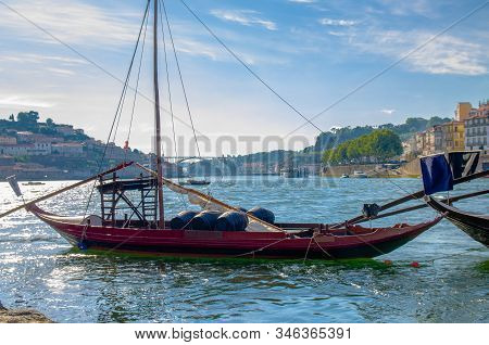 Portugal, Porto In Summer, Panoramic View Of  Douro River, Red Wooden Boat With Wine Port Barrels Cl