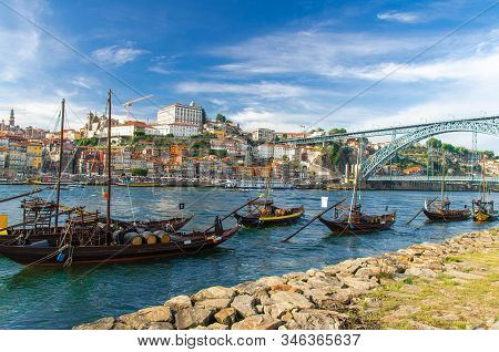Portugal, City Landscape Porto, Wooden Boats With Wine Port Barrels Close Up On Douro, Panoramic Vie