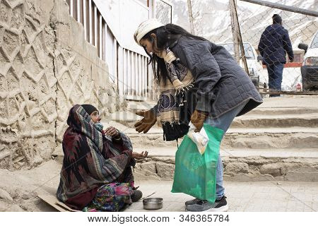 Travelers Thai Women Give Money To Old Indian Old Woman Beggar Or Untouchables Caste Sit And Begging